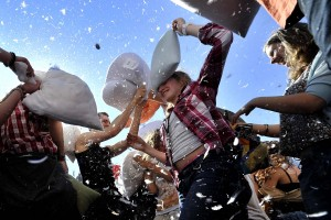 People attend a flash-mob pillow fight d