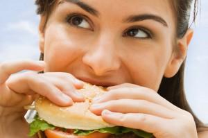 Teenage-girl-eating-a-hamburger-692189