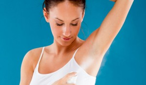 WomanSprayingDeodorant_article_new