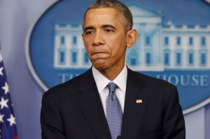 U.S. President Obama listens to a question after his end of the year press conference in the briefing room of the White House in Washington