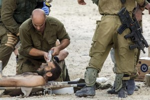140720-israel-soldier-injured-1020a_f7c68d9f367284a7b5909bc7ee595a91