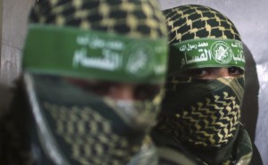 Members of Hamas' armed wing are seen inside a lift after attending a news conference in Gaza City
