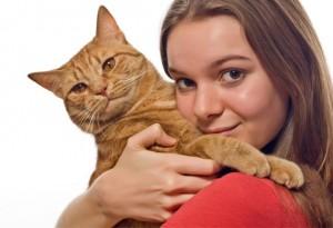 woman_holding_hugging_cat
