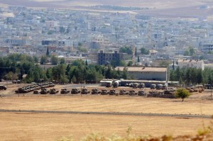 Turkish tanks take position near the border with Syria at Suruc in Sanliurfa