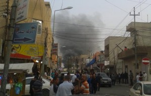 Smoke rises from the site of a bomb attack in Erbil, the capital of Iraq's Kurdistan region