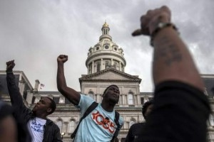 "Residents, who marched from west Baltimore to City Hall, shout ""Black Lives Matter"" while protesting the death of Freddie Gray, in Baltimore, Maryland"