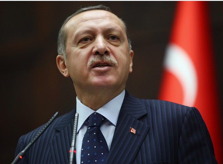 Turkey's Prime Minister Recep Tayyip Erdogan addresses his party members at the parliament in Ankara, Turkey, Tuesday, Nov. 22, 2011. Erdogan said for the first time that Syria's president must step down over the country's brutal crackdown on dissent, ratcheting up the pressure on the increasingly isolated Bashar Assad. In his harshest words yet, Ergodan reminded Assad of the bloody end of the Libyan leader Moammar Gadhafi, as well as past dictators, including Adolf Hitler.(ddp images/AP Photo)