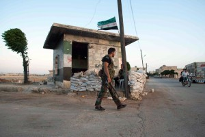 Members of the Free Syria Army stand gua