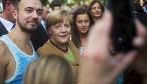 "German Chancellor Angela Merkel poses with visitors at the Chancellery during the government's ""Open Door Day"" in Berlin, Germany"