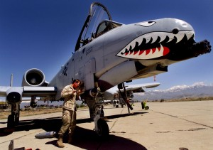 STAFF SERGEANT HAAS OF THE US AIR FORCE ADJUSTS EQUIPMENT ON A10THUNDERBOLT AT BAGRAM AIR BASE.