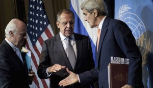 UN Special Envoy for Syria de Mistura watches as Russian Foreign Minister Lavrov and US Secretary of State Kerry shake hands after a news conference at the Grand Hotel, in Vienna
