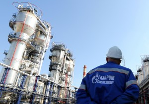 A Gazprom employee stands near to the new bitumen processor at the OAO Gazprom Neft oil refinery in Moscow, Russia, on Thursday, Sept. 20, 2012. OAO Gazprom Neft, the oil arm of Russia's state-run natural-gas producer, started operating a 3.2 billion-ruble ($100 million) bitumen processor at its Moscow refinery this month as it seeks to reduce pollution. Photographer: Andrey Rudakov/Bloomberg