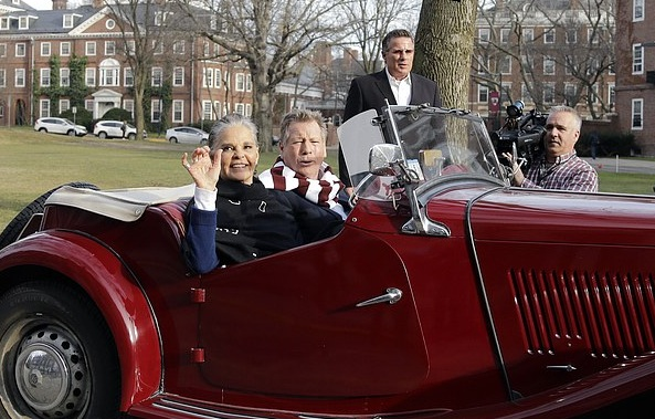 "Actors Ali MacGraw, left, and Ryan O'Neal drive up in an antique MG convertible on the campus of Harvard University in Cambridge, Mass., Monday Feb. 1, 2016, more than 45 years after the release of their 1970 classic ""Love Story."" The duo, now in their 70s, currently are co-starring in a national tour of ""Love Letters,"" which is about a man and a woman who maintain contact over 50 years through notes, cards and letters. (AP Photo/Elise Amendola)"