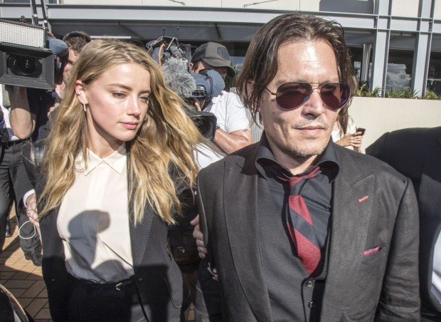 Actor Johnny Depp (R) and wife Amber Heard arrive at the Southport Magistrates Court on Australia's Gold Coast, April 18, 2016. Hollywood actor Johnny Depp's wife, actress Amber Heard, appeared in the Queensland court Monday charged with illegally smuggling the couple's Yorkshire terriers, Pistol and Boo, into the country on a private jet while Depp was shooting a Pirates of the Caribbean movie last year. REUTERS/Dave Hunt/AAP ATTENTION EDITORS - THIS PICTURE WAS PROVIDED BY A THIRD PARTY. IT IS DISTRIBUTED EXACTLY AS RECEIVED BY REUTERS, AS A SERVICE TO CLIENTS. FOR EDITORIAL USE ONLY. NOT FOR SALE FOR MARKETING OR ADVERTISING CAMPAIGNS. FOR EDITORIAL USE ONLY. NO RESALES. NO ARCHIVE. AUSTRALIA OUT. NO COMMERCIAL OR EDITORIAL SALES IN AUSTRALIA. NEW ZEALAND OUT. NO COMMERCIAL OR EDITORIAL SALES IN NEW ZEALAND. TPX IMAGES OF THE DAY - RTX2AEJL