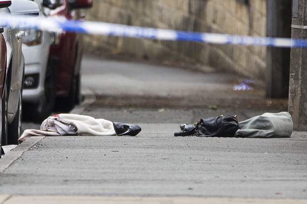 © Licensed to London News Pictures. 16/06/2016. Leeds, UK. Picture shows a ladies handbag & shoes at the scene where Police are at the scene in Birstall, south of Leeds, where Jo Cox, Member of Parliament for Batley and Spen, has been shot and stabbed during a constituency surgery. Photo credit: Andrew McCaren/LNP